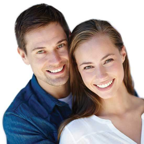 Couple smiling together after getting their porcelain veneers