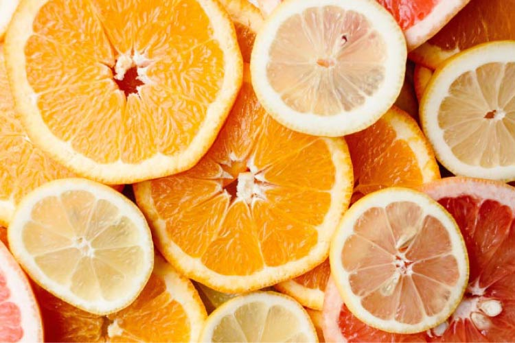 slices of citrus fruit that can be harmful to teeth