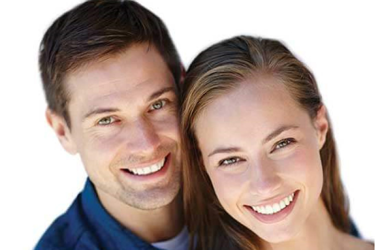 young couple smiling showing off their dental veneers